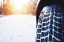 Car tires on winter road