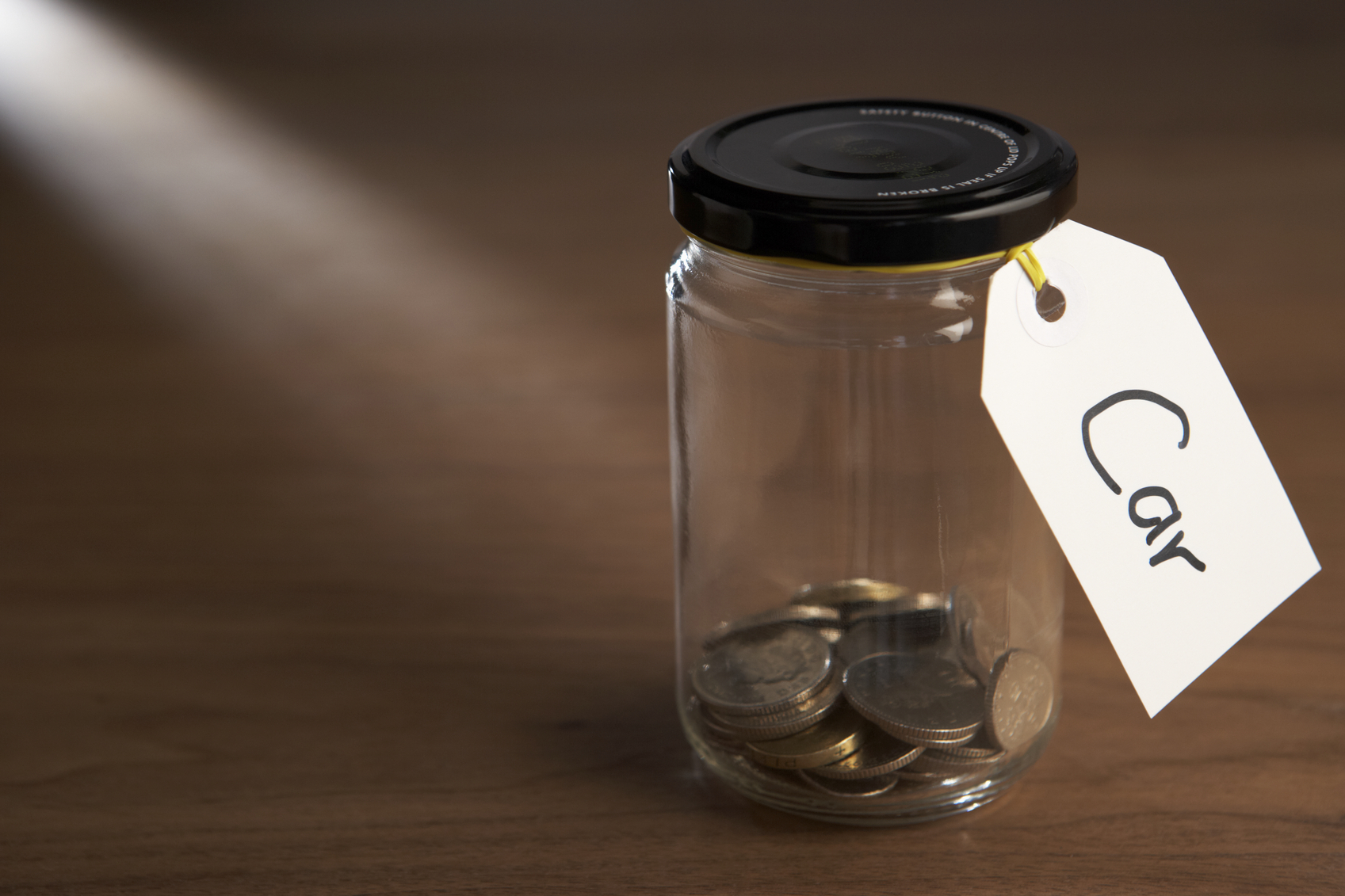 Coins in a jam jar With Labelled Attached