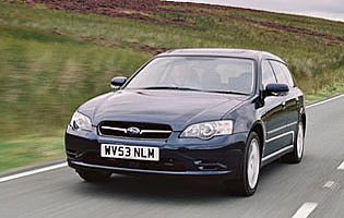picture of subaru legacy on the road