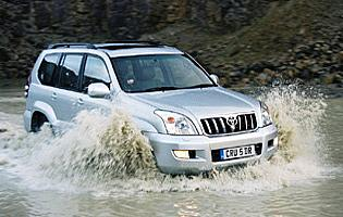 picture of Toyota land cruiser driving through water splash