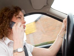 Lady driving while on a mobile phone