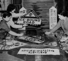 Making ice-bound road signs