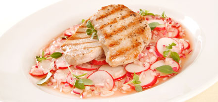 Barbecued pork mini steaks with radish salad
