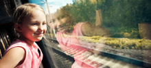 Girl looking out of train window