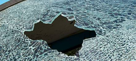 When struck toughened glass breaks into thousands of pieces