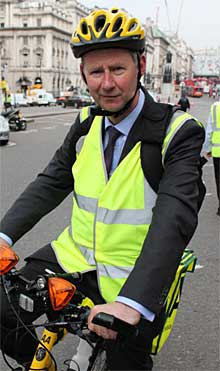 Edmund King, AA president rides an AA bicycle