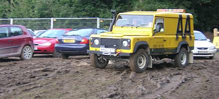 Rain can quickly turn a field full of cars into a slippery, muddy bog