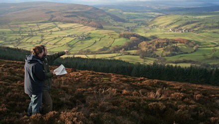 Checking the map on Barden Moor – copyright YDNPA