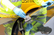 A windscreen being repaired by an AA technician