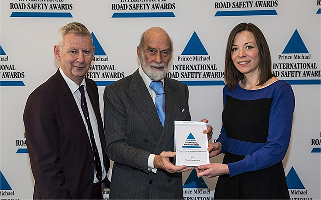 AA Trust Director Edmund King and AA Campaigns Manager Lorna Lee receive an award from Prince Michael of Kent