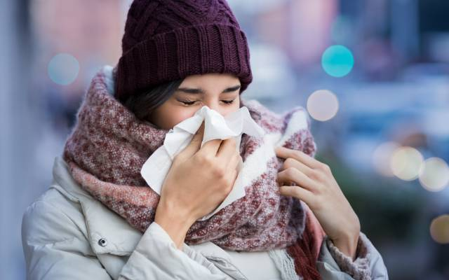Sneezing woman cold