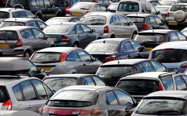 Factors that affect car insurance premiums - a crowded car park full of cars