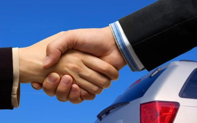 Shaking hands and car