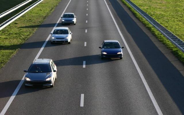 Four cars driving on a motorway