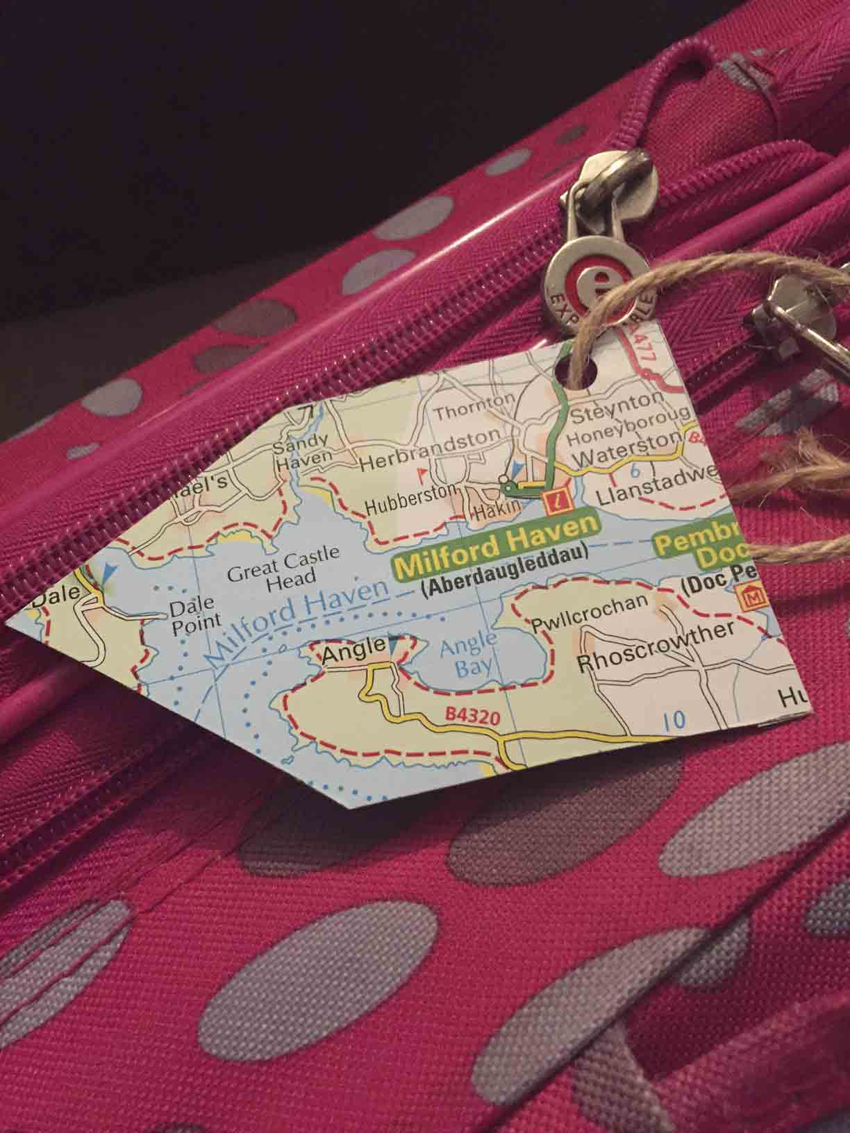 Luggage tag made from old atlas